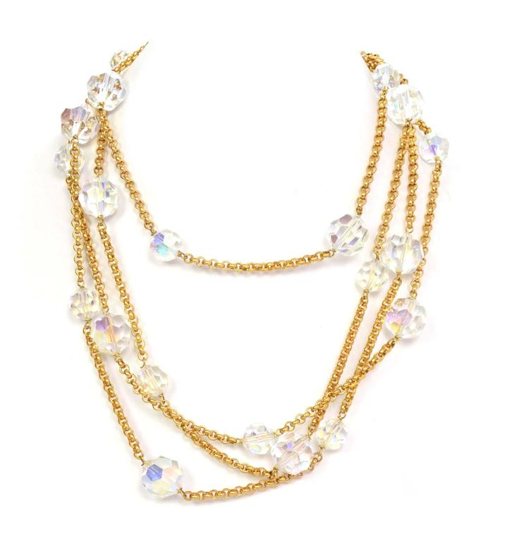 Chanel Vintage '88 Gold Chain Link Crystal Beaded Long Necklace  Features graduated crystal beads  Made In: France Year of Production: 1988 Color: Goldtone and clear iridescent Materials: Crystal beads and metal Closure: Lobster claw