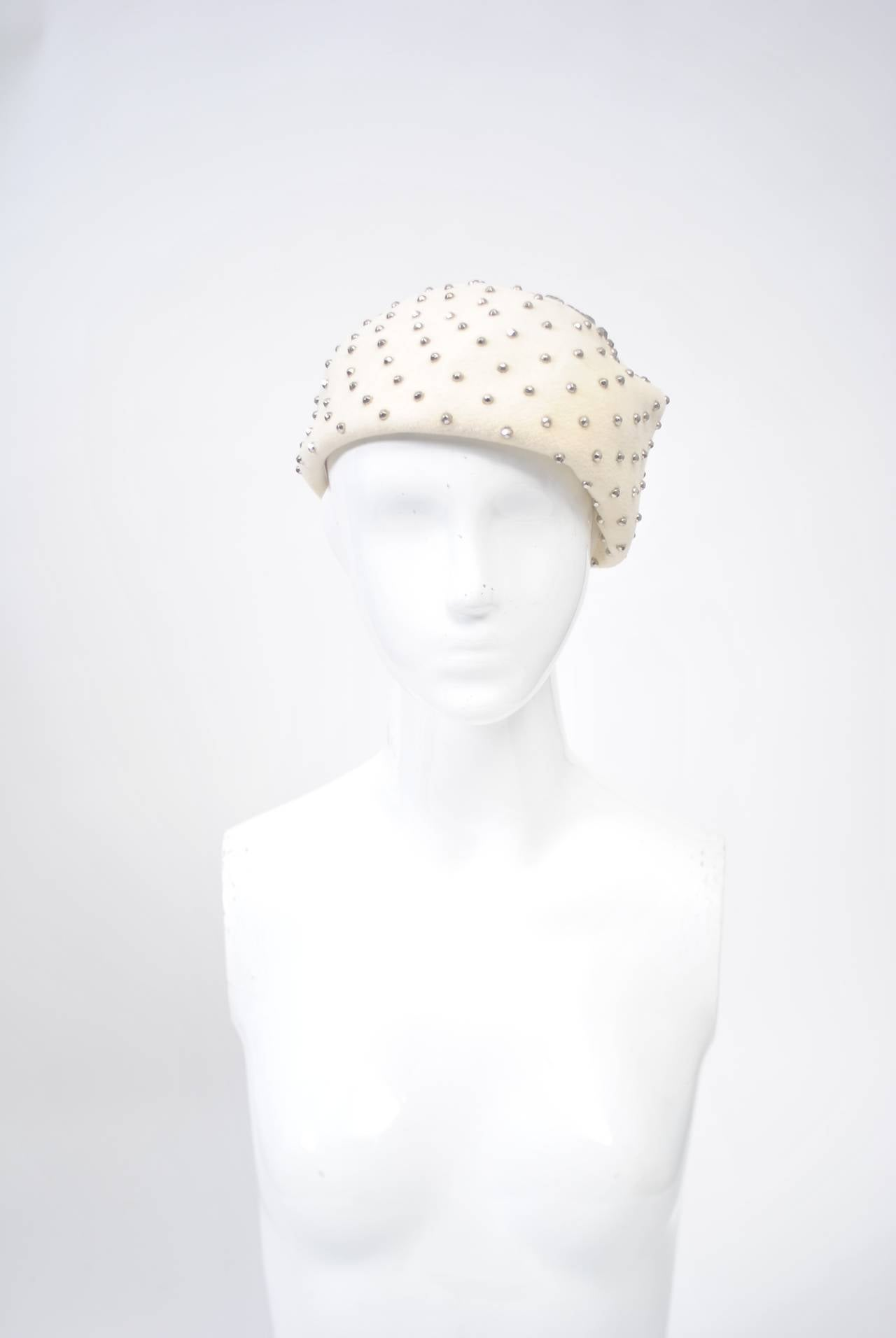 """A silver-studded beret from the 1960s shaped to tilt on the head. The crown is studded in an arresting star-shaped pattern. Interior measures 22.5"""" - small to medium head size."""