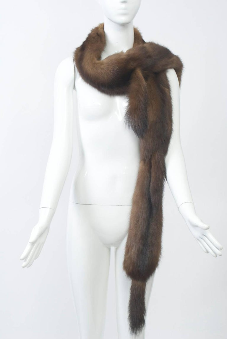 Long sable scarf composed of multiple skins and terminating in tails at the end as well as where the skins meet in front. Sable on reverse. Wear it different ways.