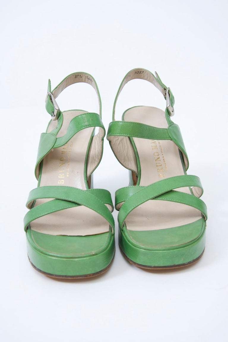 Iconic 1970s platform sandals by Bruno Magli in bright green leather featuring crossed straps in front, a buckled strap in back, and a 3 1/2