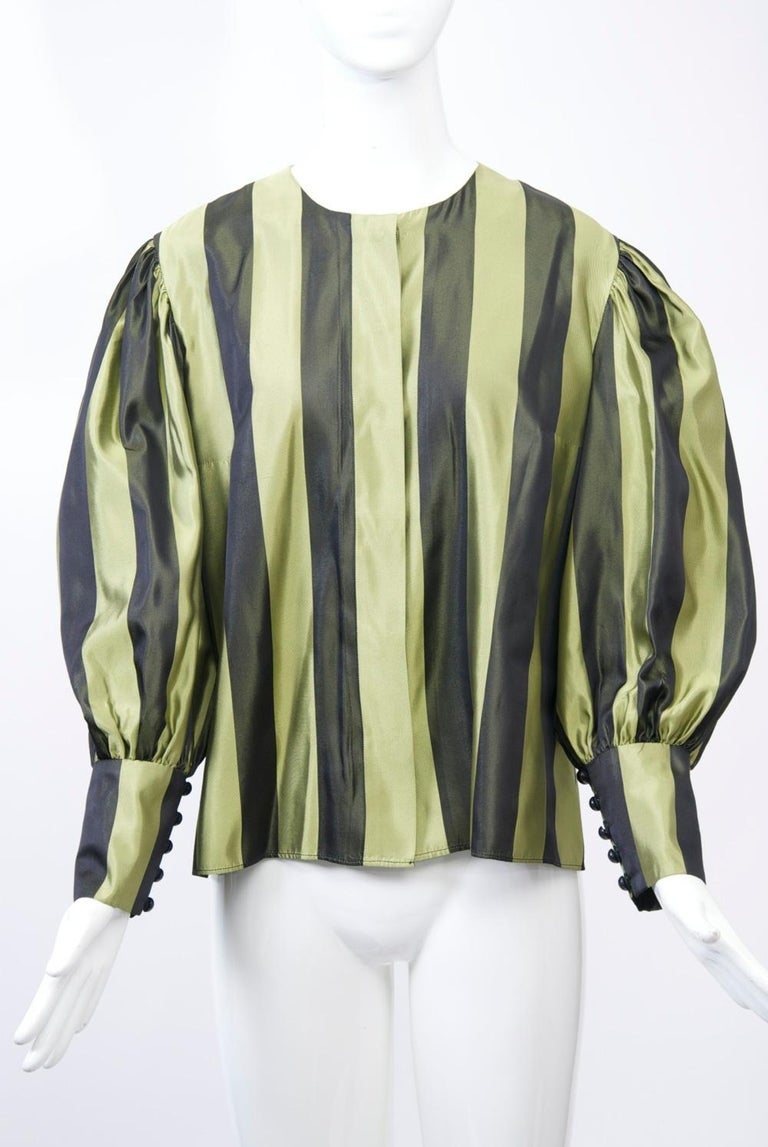 Blouse and shawl ensemble in pale olive and black striped silk, the collarless blouse featuring hidden buttons and juliet sleeves with deep buttoned wrists. The shawl, matching stripes on one sde, black velvet on the other, is long and deep. The