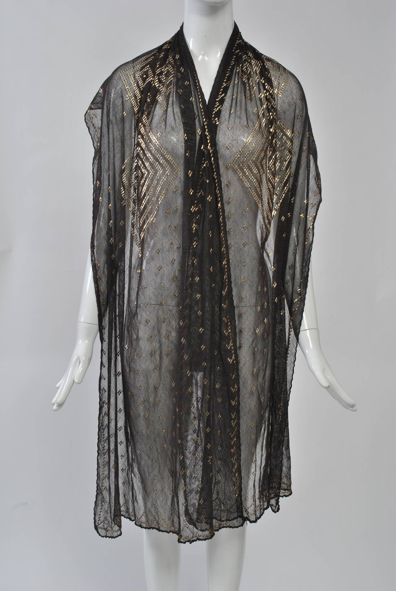 Black assuit shawl with silver metal embroidery in a geometric design. These were made in Egypt and especially popular during the 1920s. Very good condition.