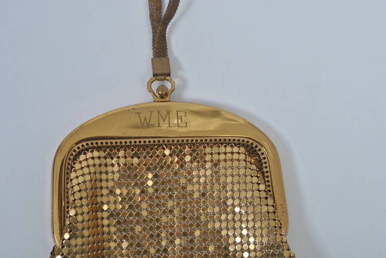 Petite gold mesh bag by Whiting & Davis with wrist strap and curved gold metal frame itch engraved initials