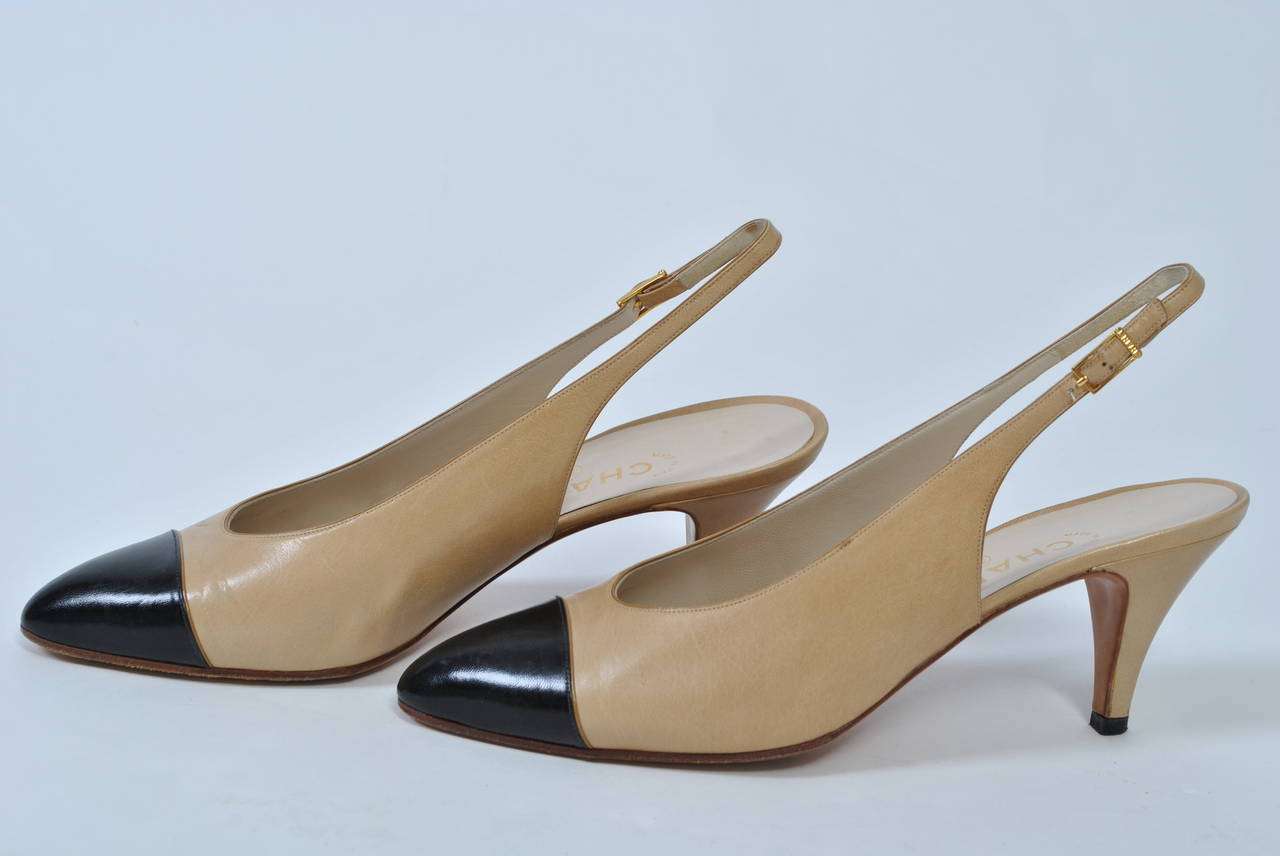 Chanel classic tan slingbacks with black cap toe, a combination fashionable today as always, as seen on the 2015 runway. Hardly worn. Size 9.