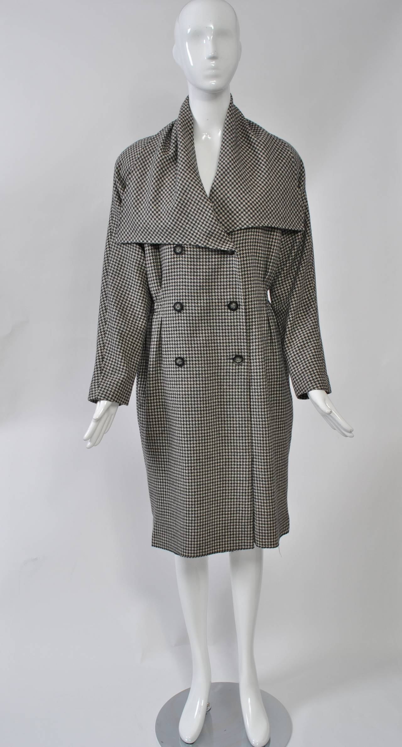 Tiktiner gray check oversized, double-breasted coatdress with a nipped waist, large collar, and raglan sleeves. Soft feel to the fabric. Looks great belted.