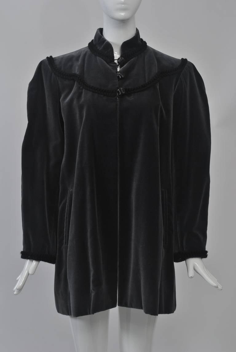 1980s YSL velvet mid-thigh jacket with black braid trim around Mandarin collar and yoke. Beautiful shade of charcoal gray.
