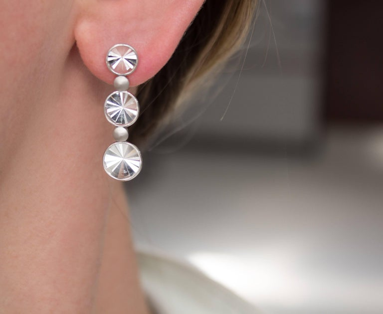 One of a Kind Waterfall Earrings handcrafted in Brazil by jewelry designer Antonio Bernardo featuring six round prism-cut rock crystal quartz elements set in matte finished and polished 18k white gold. Stamped 750 / Antonio Bernardo / with AB