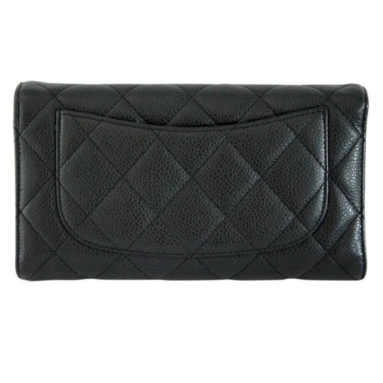 084b989fd1be35 Company: Chanel Style: Long Flap Wallet Wallet Measurements: 7.25