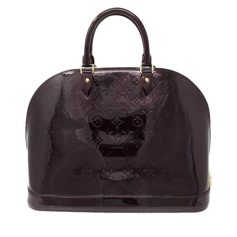 Brand: Louis Vuitton Handles: Patent Leather (Vernis) Amarante Rolled Handles; Drop: 4