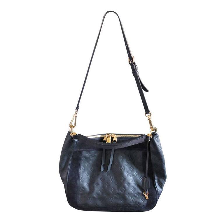 1ad611304d4b1 Louis Vuitton Audacieuse Navy Blue Suede Empreinte Leather Handbag For Sale  4