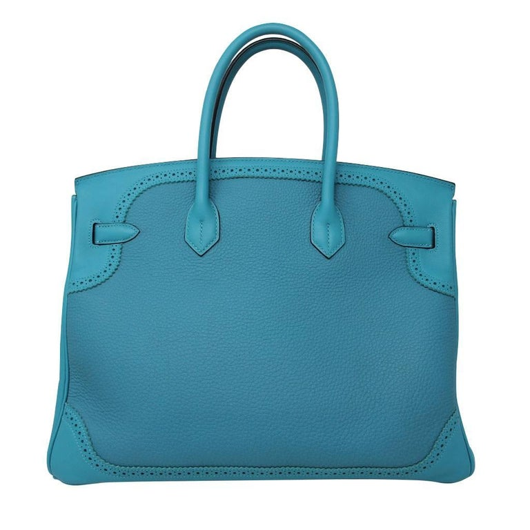 "Brand: Hermes Style: Birkin Ghillies 35 Handbag Handles: Rolled Swift Leather Handles Drop: 4.25"" Measurements: 14"" L x 7"" D x 11"" H Materials: Turquoise Ghillies Design Togo and Swift Leather  Hardware & Lining: Turquoise Swift Leather, Palladium"