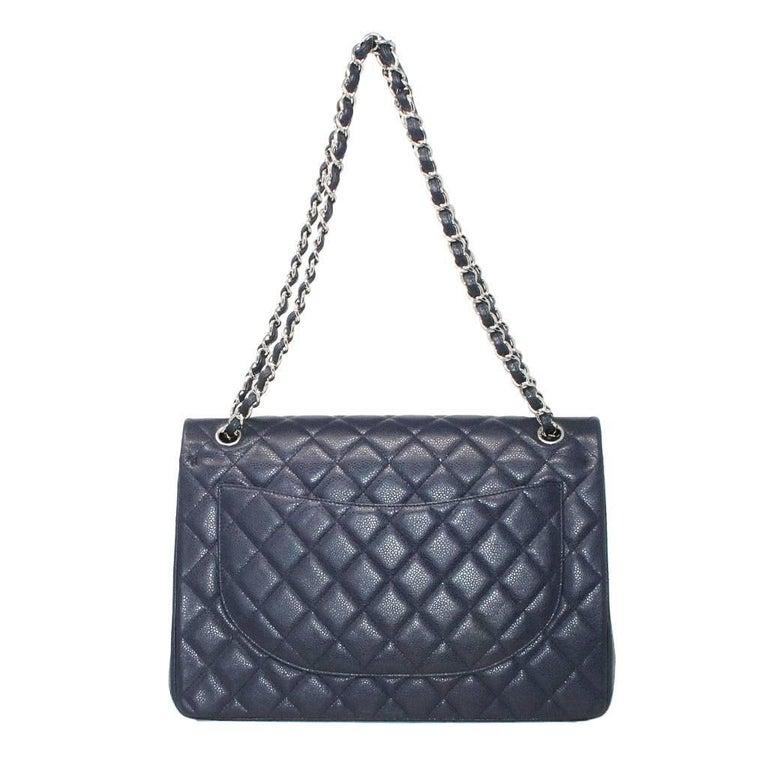 Brand: Chanel Handles: Braided Palladium Chain with Navy Blue Caviar Leather Drop: 19