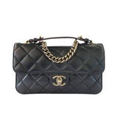 CHANEL Black Lambskin Cutout Thick Gold Hardware Flap Bag