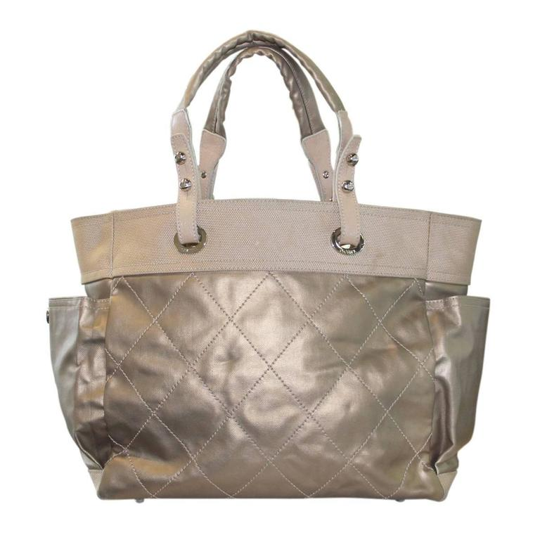 Brand: Chanel Handles: Coated Canvas and Nylon Shoulder Straps; Drop: 7.5