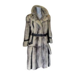 Exclusive cross mink fur knee length coat with leather details