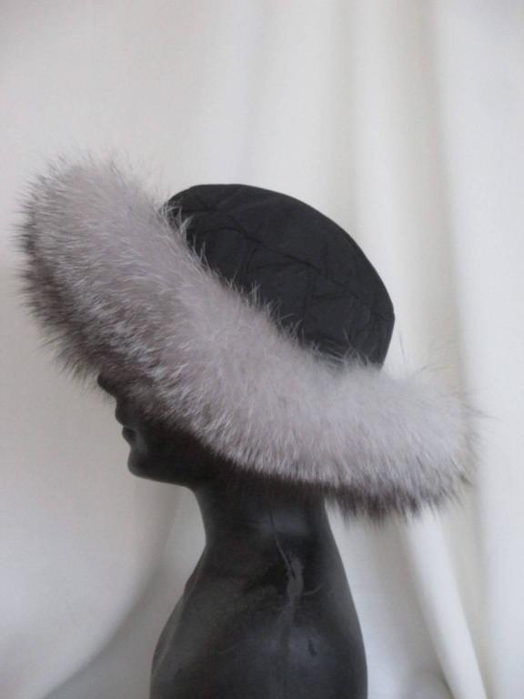 This hat has a black soft fabric top and is very light to wear and easy to fold for travelling.