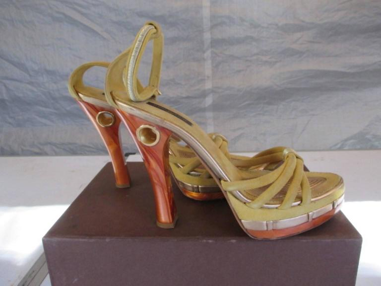 Authentic Louis Vuitton limited edition yellow suede and gold leather Cleo Pompeii sandals.  Features an open toe, faux tortoiseshell accents, a 1.25 inch platform, a tortoiseshell resin heel, and a natural leather sole. Includes Louis Vuitton box.