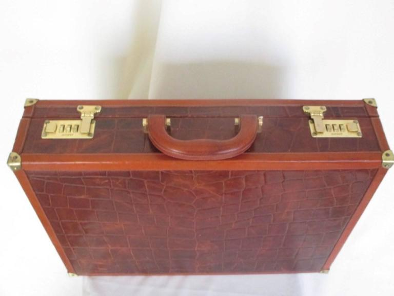 This briefcase is made in Italy by Conte Max it has gold hardware and have some wear at the leather . The interior is made of suede . Its in very good vintage condition. Size 47 cm x 35 cm x 10 cm