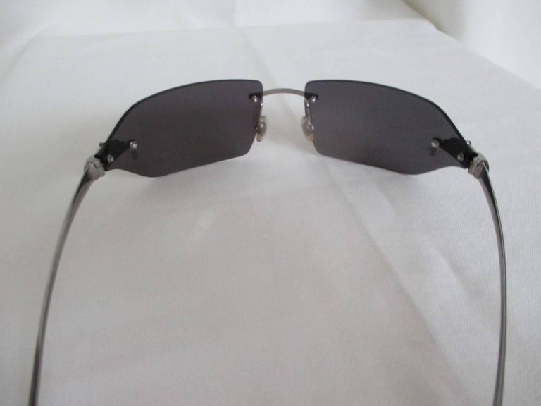 2971df54253 Cartier sunglasses with grey-tinted rimless lenses and platinum finish  hardware with the signature Panthere
