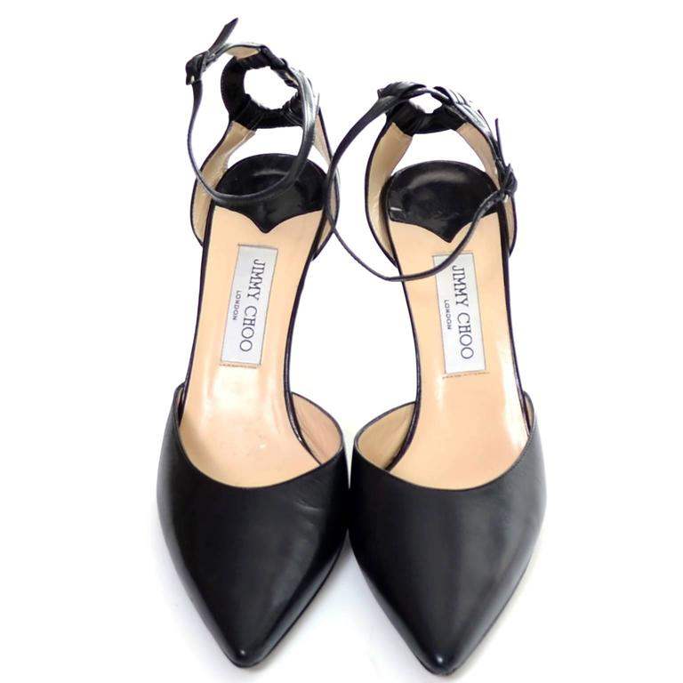 These Jimmy Choo black leather ankle strap shoes have 4