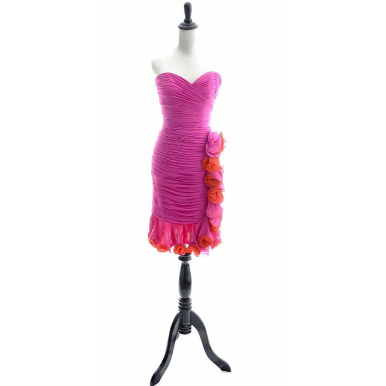 This is a fabulous vintage dress from the 1980's by A.J. Bari! The fit of this micro pleated wiggle dress is sublime with the heart shaped bust line and the curve hugging shape. I also love the colors - bright pink and orange, and the pretty loopy