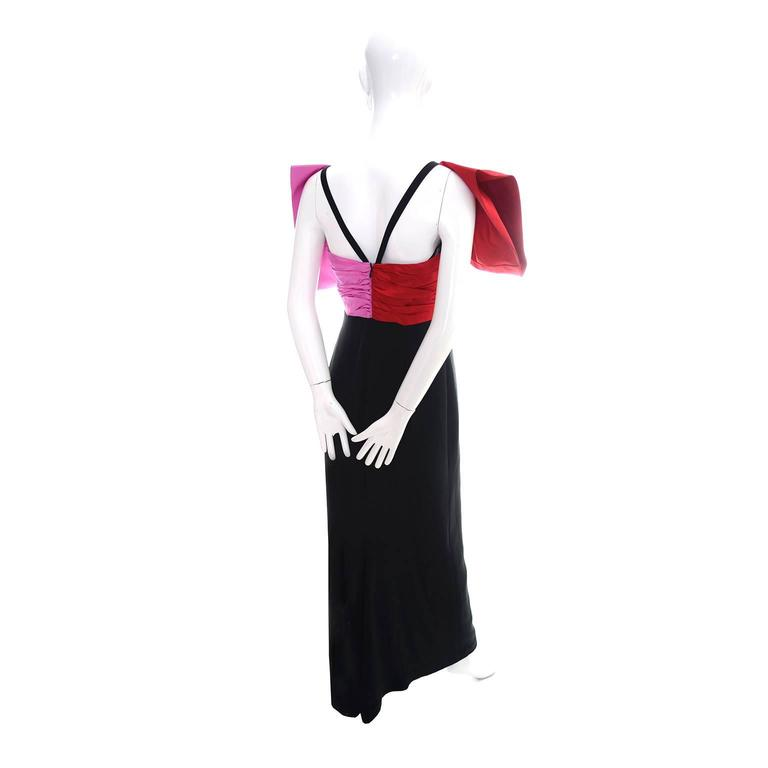 This is an outstanding vintage dress from Bill Blass that definitely makes a statement with its beautiful pink and red oversized bow.  The slim fitted black crepe dress is figure flattering and closes with a back zipper.  The built in corset with