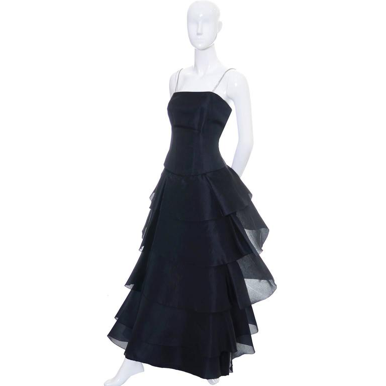 This dramatic black, full length 100% silk statement dress was designed by Akira Isogawa, one of Australia's most important designers. Isogawa was born in Kyoto Japan and moved to Australia in 1986 to study fashion design at the Sydney Institute