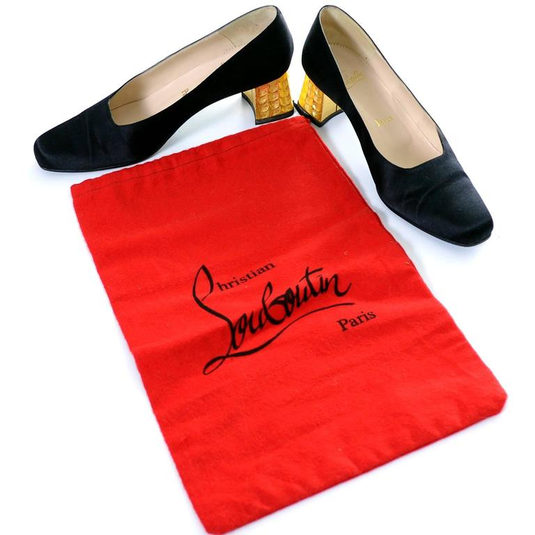 These are important black satin vintage shoes with gold leaf heels from Christian Louboutin.  Made in Italy in 1992, I am fortunate to have 2 different magazine documentations that show the shoes as part of fashion spreads.  These shoes have their