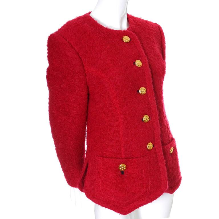 This vintage red boucle wool blazer was designed by Yves Saint Laurent in the late 1980's or early 1990s. The jacket is fully lined and has beautiful buttons and front pockets.  This piece comes from a collection of YSL vintage clothing that I