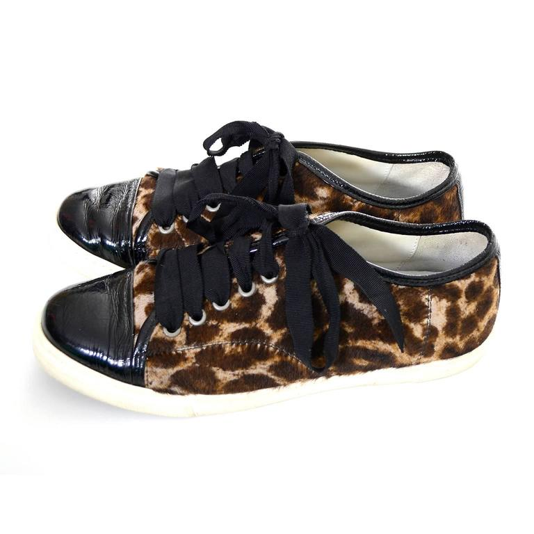 This is a fabulous pair of pony hair low top sneakers from Lanvin with black patent leather trim.  These sneakers appear to have only been worn once or twice and are labeled a size 38 which is approximately a US size 7 and 1/2.  The shoes are 3 and