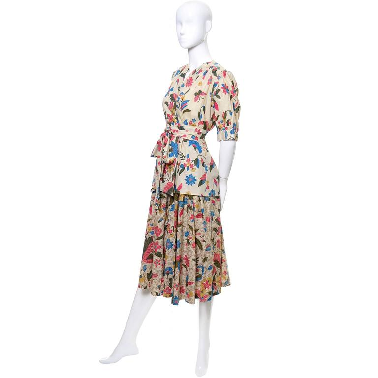 This vintage 2 piece peasant day dress outfit from Yves Saint Laurent is from one of our more memorable estates of vintage clothing and accessories. This is an incredible outfit with a full skirt and a button front blouse or jacket that can be worn