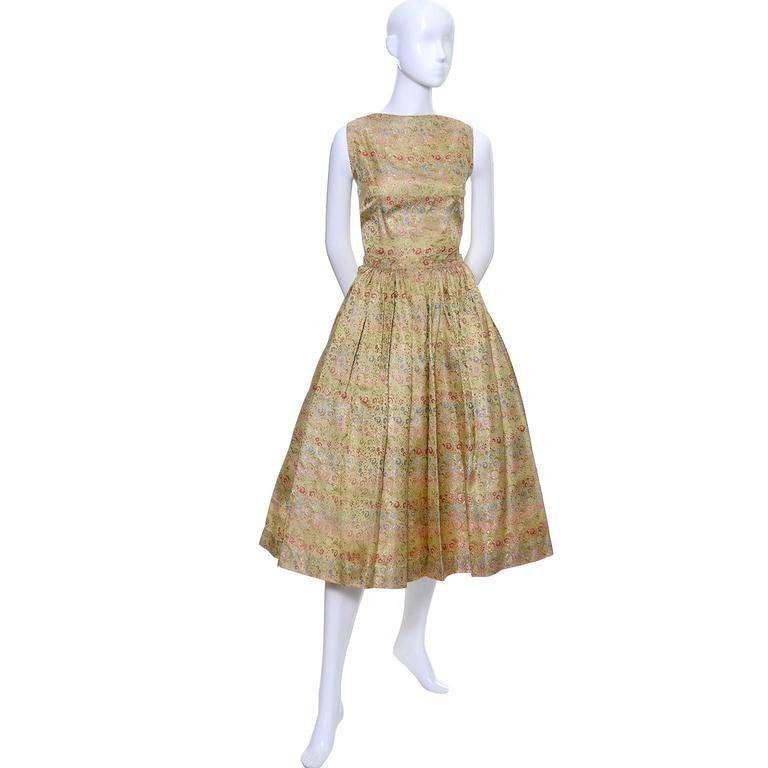 This is a rare, late 1950's early Nelly de Grab vintage brocade 2 piece gold dress with tiny multi colored flowers.  She was known for her more casual cotton prints and day dresses, but this is an early example of her more elegant designs. Press