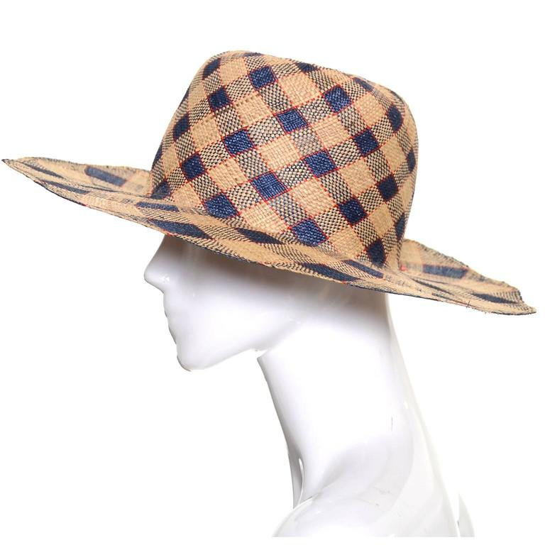 This vintage hat was designed by Therese Ahrens and was purchased at Bullock's Wilshire in the late 1960's.  This straw hat is navy and natural plaid with fine red lines and the shape is a nonagon with 9 squared off edges.  This hat came from an