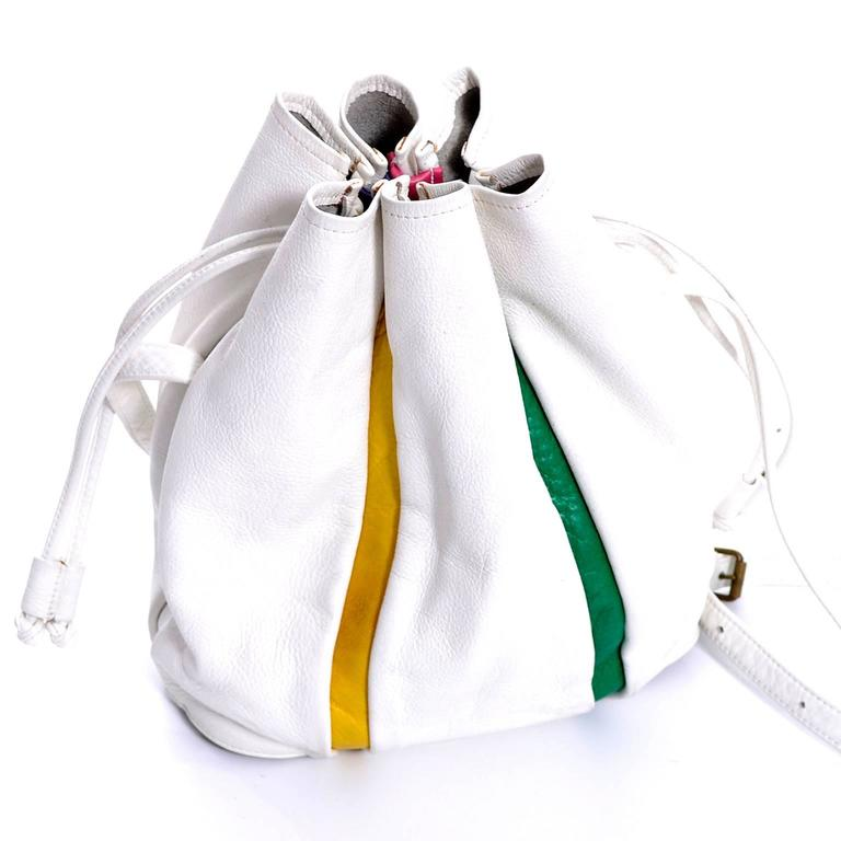 This vintage white leather handbag has leather panels in pretty jewel tones. This bag was made in the early 1970's for Saks Fifth Avenue and has a drawstring and an adjustable shoulder strap. I love the look of this bucket bag - it is 12