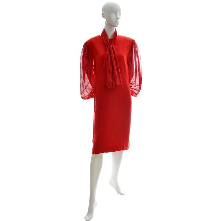 This red vintage linen blend Pauline Trigere dress has semi sheer red sleeves with blue stripes, a back zipper and a separate scarf that is made in the same fabric as the sleeves.  This dress was purchased at Saks Fifth Avenue in the 1980's and I