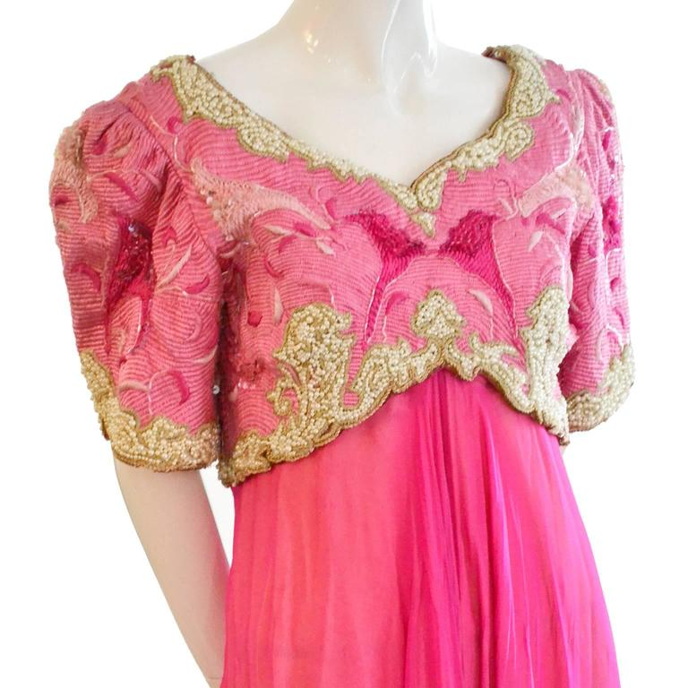 This is an exceptional Richilene New York vintage 1980's formal evening gown in pink silk chiffon with a heavily embroidered, beaded over - bodice with stacked sequins.  There are beautiful seed pearls and the embroidery includes shades of pink and