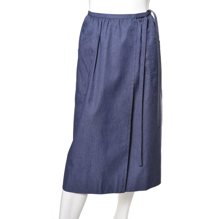 This is another vintage YSL piece from an estate of vintage Yves Saint Laurent clothing from the 1970's and early 1980's.  This pretty chambray skirt has pockets and connects with 2 hooks and eyes, with the appearance of a wrap skirt.  This skirt,
