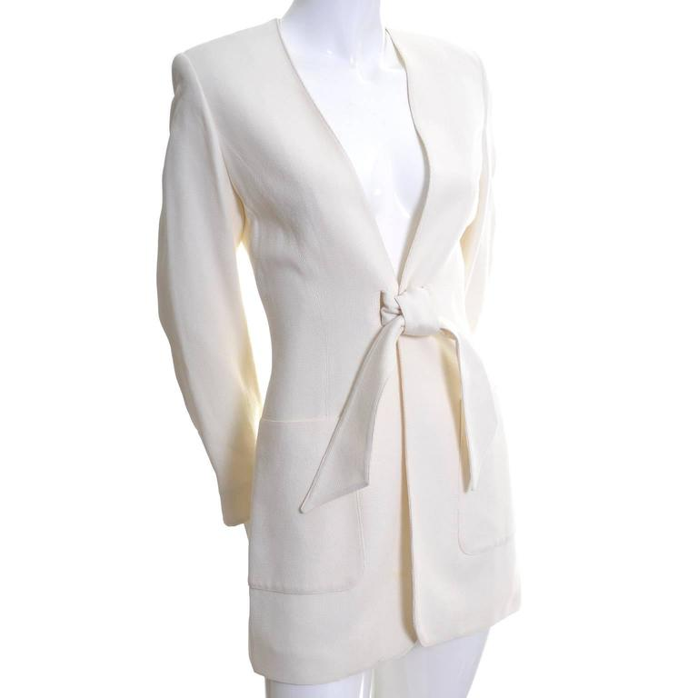 This is a beautiful Claude Montana vintage blazer from the 1980's. The jacket has two slits in the front that are closed with a sash. There are shoulder pads, front pockets, and the blazer is fully lined.  The fabric feels like a silk or silk/linen