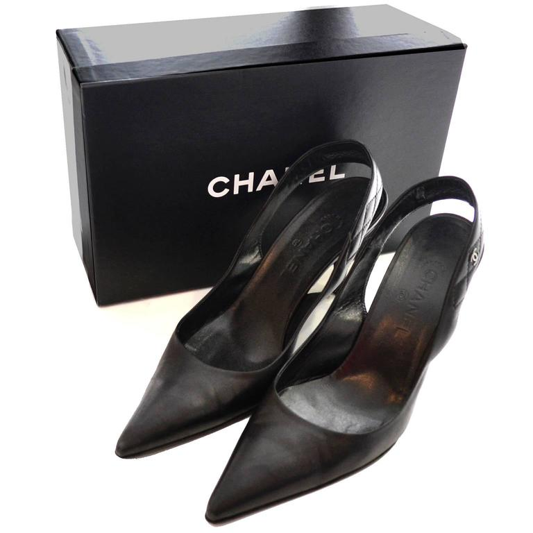 This is a pair of black leather slingbacks from Chanel in their original box. These shoes come with the Chanel envelope with the Karl Lagerfeld mini booklet and a pair of extra heel tips.  These were purchased at Saks Fifth Avenue in San Francisco