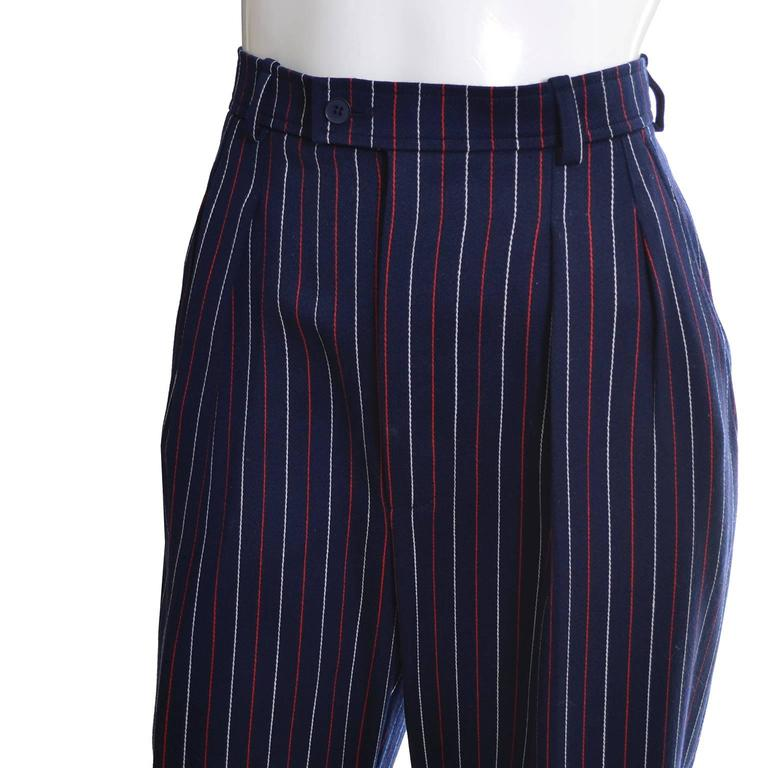 These vintage YSL lightweight fine wool pinstriped pants came from an incredible estate of designer vintage clothing.  The woman who owned these hardly, if ever, wore any of her clothing so most of it was in as new condition, including these pants!