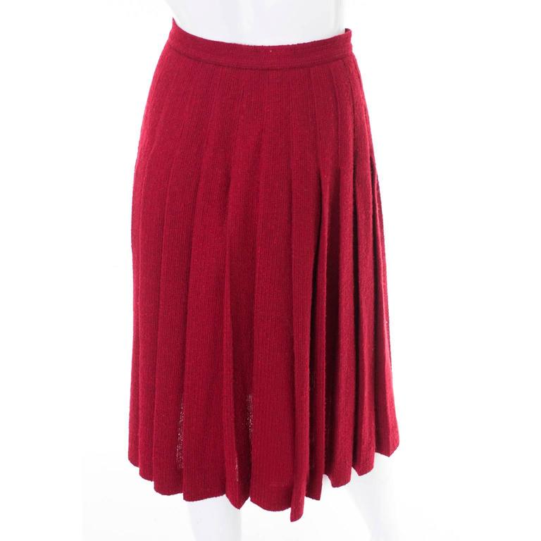 This gorgeous vintage skirt was designed by Yves Saint Laurent in the 1990s.  The skirt is beautifully pleated and has nice gold buttons on the front at the side.  The back of the skirt is fully pleated and the front shows pleating on the sides.