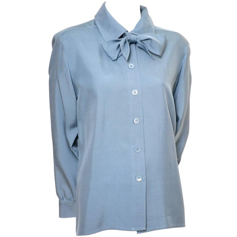 d222ea50f6f This pretty vintage blue silk blouse was designed by Yves Saint Laurent in  the late 1970's