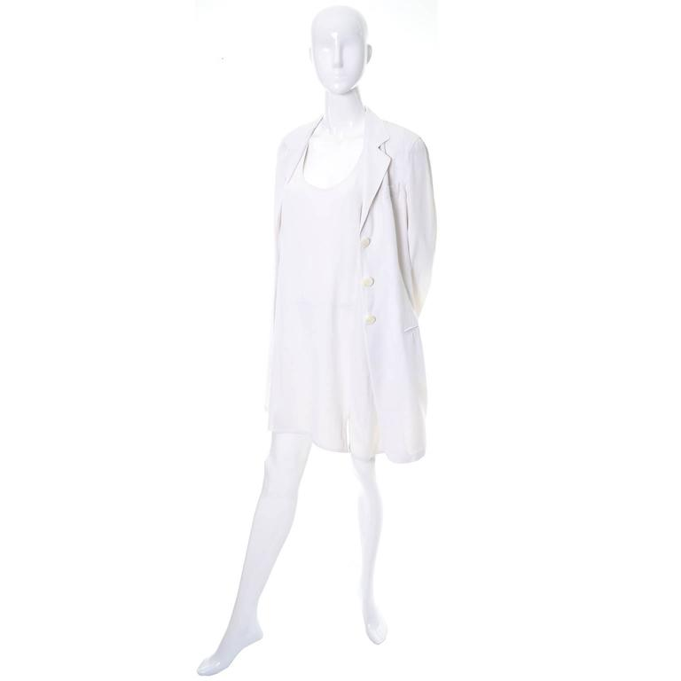 This pretty 2 piece vintage outfit was designed by Donna Karan and made in Italy in the 1990's.  This includes a racer back shift dress with a small slit and a long single breasted coat with front pockets.  The fabric is an ivory/white acetate linen
