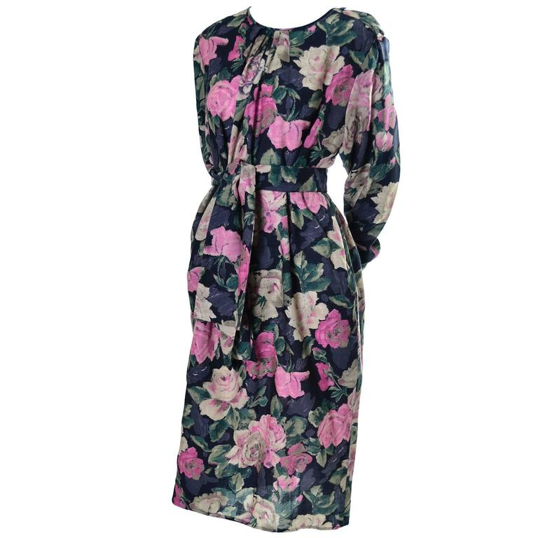 This vintage late 1980's dress was designed by Emanuel Ungaro and bears the Ungaro Ter label.  This pretty floral vintage dress is made of 90% wool and 10% nylon and it has slight shoulder pads, side slit pockets and buttons on the shoulder. There