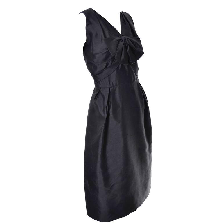 I love this vintage little black dress! This sensational black silk sleeveless dress was designed by Adele Simpson and purchased at the exclusive boutique Nicholas Ungar in the late 1950's. I love the bow on the bodice and the sash that drapes