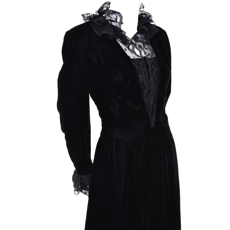 This 1970's vintage Albert Nipon Victorian renaissance evening dress is really amazing.  This  beautiful satin faced black velvet dress has a built in satin and tulle slip underneath.  The bodice, collar and cuffs are trimmed in a lovely black lace
