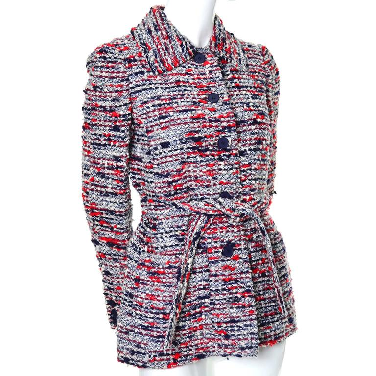 If you love Jean-Louis Scherrer, you will love this fabulous red white and blue jacket with matching sash belt.  This cotton boucle knit jacket buttons up the front and has two front pockets.  The jacket is fully lined in beautiful navy blue satin.