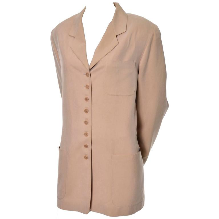 This beautiful sueded silk blazer was designed by Emanuel Ungaro and was made in Hong Kong in the late 1980's or early 1990's.  This versatile jacket is fully lined and has front pockets, light shoulder pads, and buttons up the front with 8 buttons.