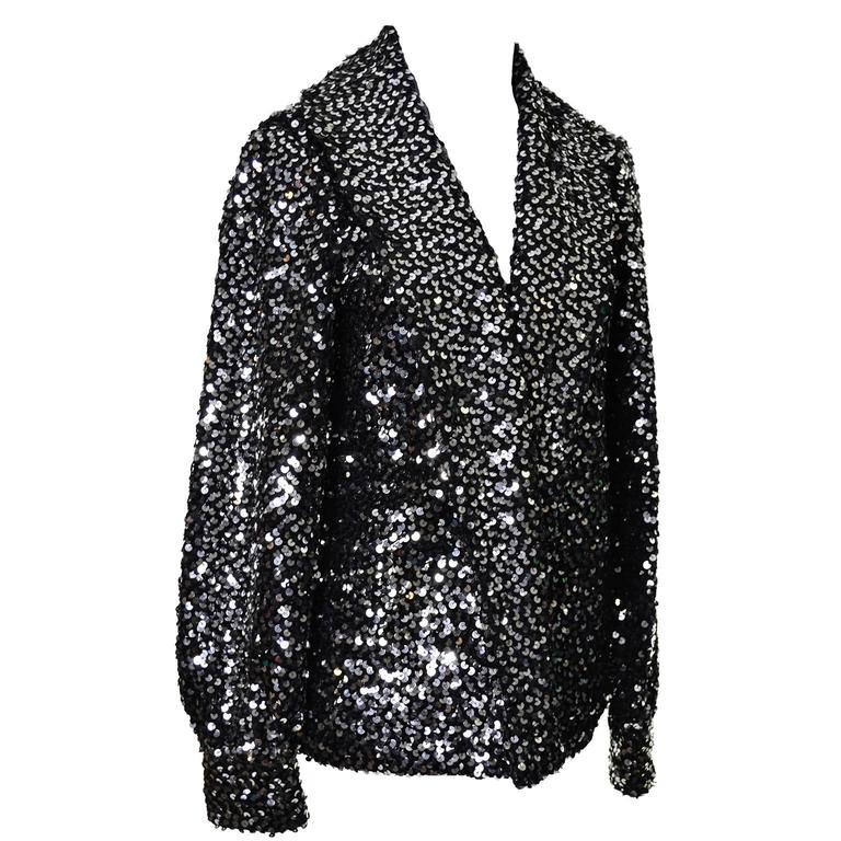 This vintage I Magnin evening jacket is the perfect companion to your cocktail dress during the holidays, or anytime during the year! The cardigan style jacket is quilted and covered in silver and black metallic sequins.  This pretty jacket has