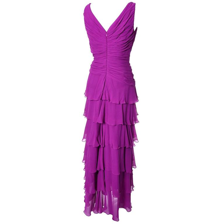 This is a beautiful orchid silk chiffon vintage dress from Tadashi.  The dress is full lined and loses with a back zipper.  There is pleating on the bodice and ruffles throughout the skirt.  This dress is in excellent condition and is labeled a size